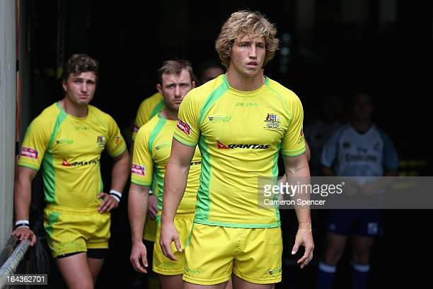 Australian captain Jesse Parahi prepares to lead his team onto the field for the match between Australia and South Africa during day two of the 2013...