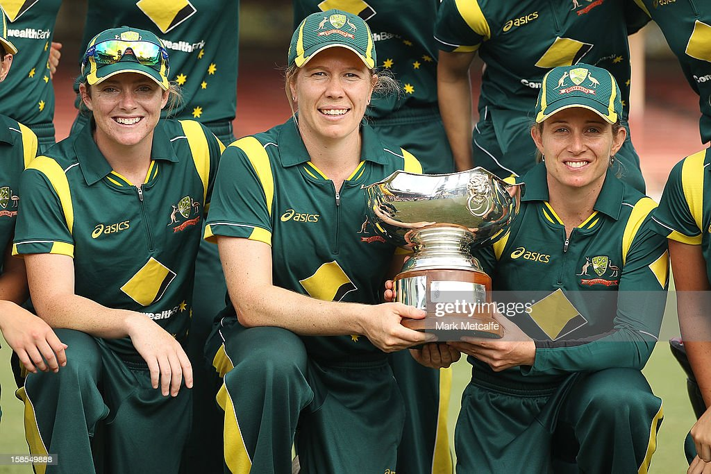 Australian captain Jodie Fields (R) and Alex Blackwell (C) pose with the Rose Bowl after winning game four of the one day international series between the Australian Southern Stars and New Zealand at North Sydney Oval on December 19, 2012 in Sydney, Australia.