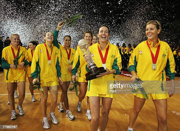 Australian captain Liz Ellis celebrates with the Netball World Cup following the 2007 Netball World Championship Final between New Zealand and...