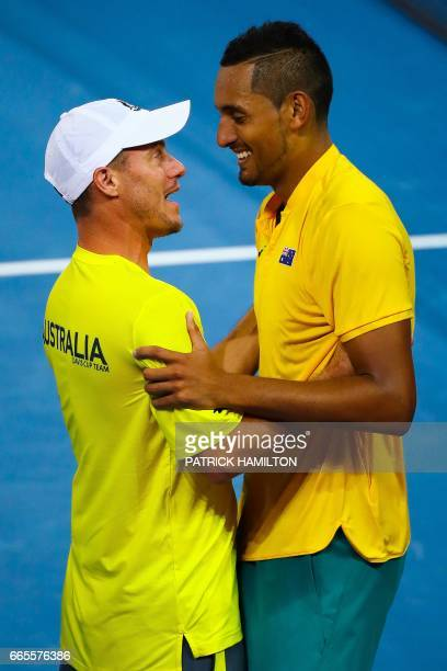 Australian captain Lleyton Hewitt congratulates Nick Kyrgios of Australia after he beat John Isner of the US in their tennis match in the world group...