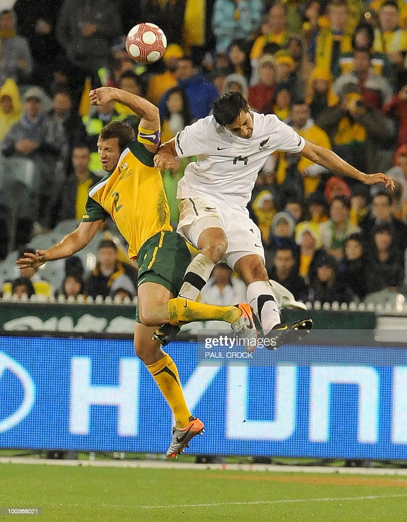 Australian captain Lucas Neill (L) and Rory Fallon of New Zealand (R) fight for the ball during their friendly international football match in Melbourne on May 24, 2010. Australia won the match 2-1. RESTRICTED