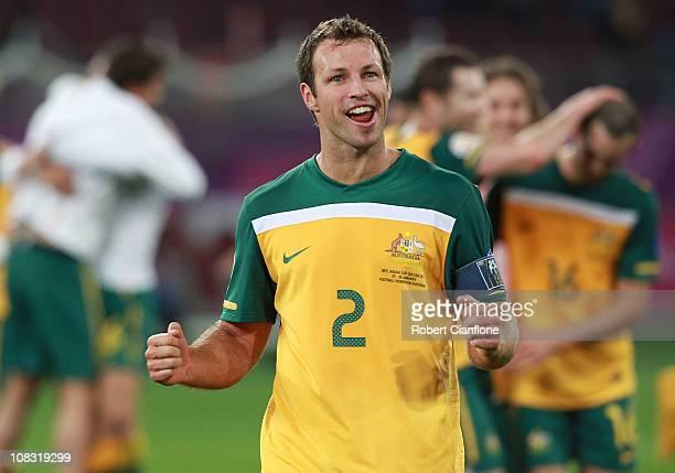 Australian captain Lucas Neill celebrates after Australia defeated Uzbekistan 60 at the AFC Asian Cup Semi Final match between Uzbekistan and the...