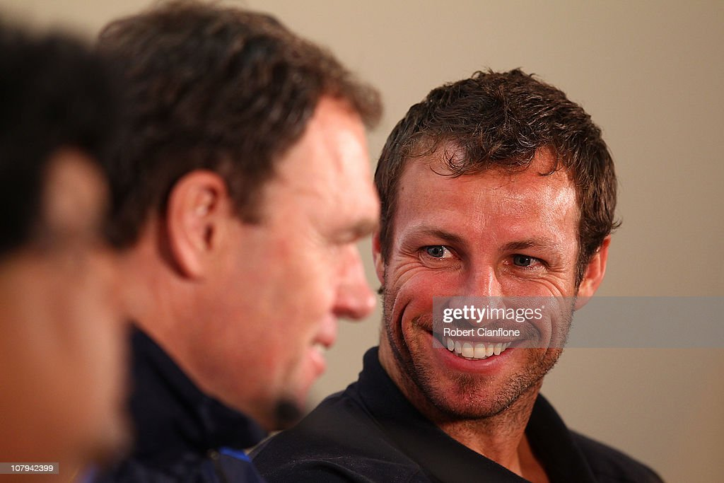 Australian captain <a gi-track='captionPersonalityLinkClicked' href=/galleries/search?phrase=Lucas+Neill&family=editorial&specificpeople=213118 ng-click='$event.stopPropagation()'>Lucas Neill</a> talks with coach <a gi-track='captionPersonalityLinkClicked' href=/galleries/search?phrase=Holger+Osieck&family=editorial&specificpeople=579862 ng-click='$event.stopPropagation()'>Holger Osieck</a> during the Australian Socceroos official pre-match media conference at the Main Media Centre, Ladies Sports Hall, on January 9, 2011 in Doha, Qatar.