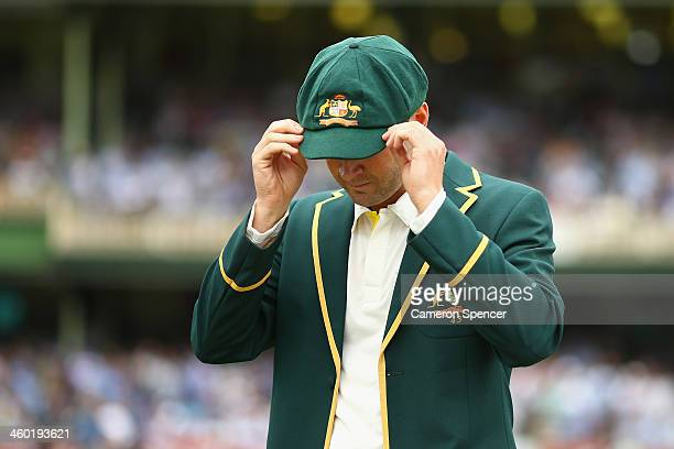 Australian captain Michael Clarke adjusts his baggy green cap during day one of the Fifth Ashes Test match between Australia and England at Sydney...