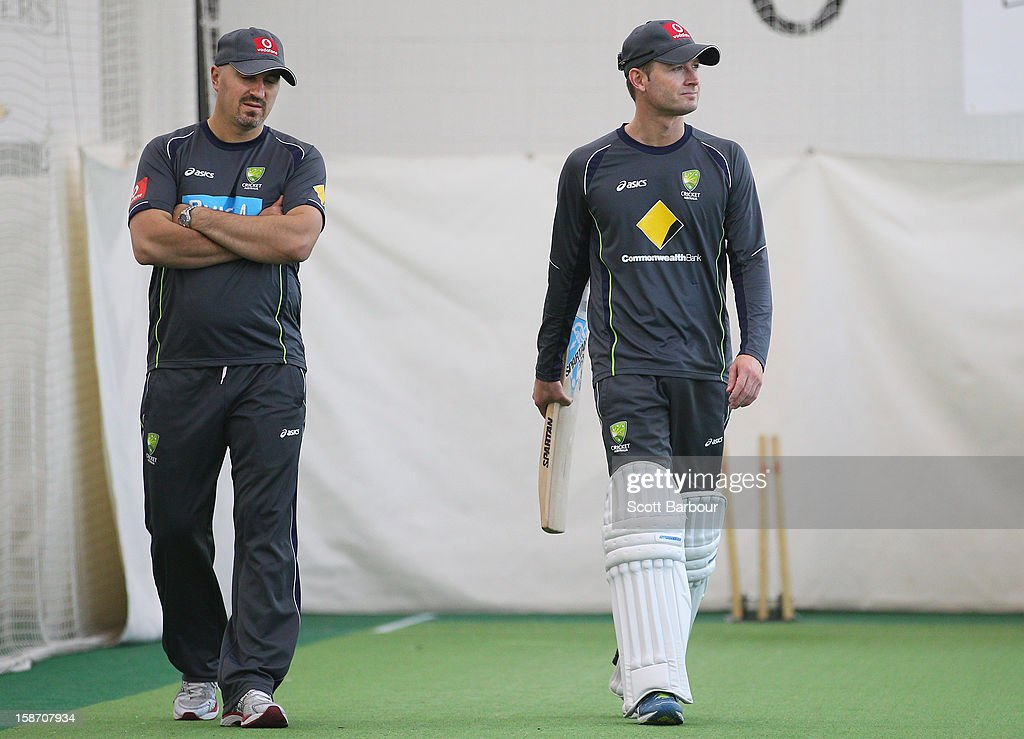 Australian captain Michael Clarke and Australian Cricket Team Physiotherapist Alex Kountouris (L) look on during an Australian nets session at Melbourne Cricket Ground on December 25, 2012 in Melbourne, Australia.