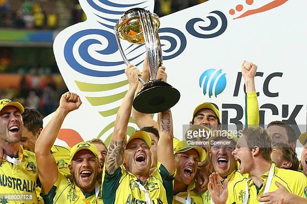 Australian captain Michael Clarke and Australian players celebrate winning the 2015 ICC Cricket World Cup final match between Australia and New...