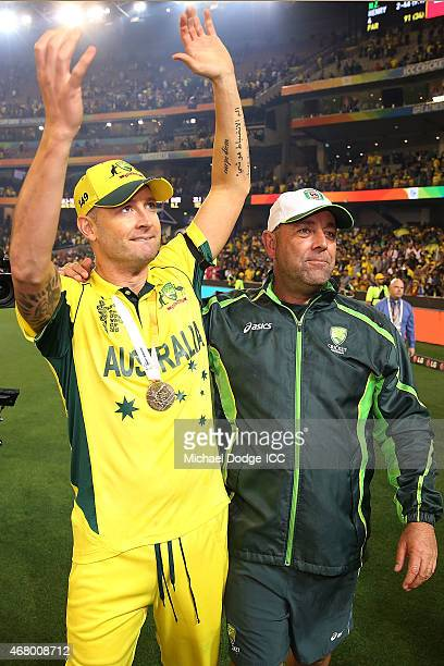 Australian captain Michael Clarke and coach Darren Lehmann celebrate after winning during the 2015 ICC Cricket World Cup final match between...
