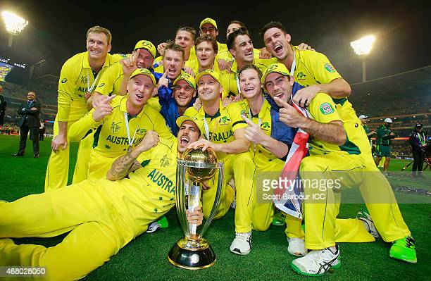 Australian captain Michael Clarke and the Australian team celebrate with the World Cup trophy as they celebrate after Australia won the 2015 ICC...