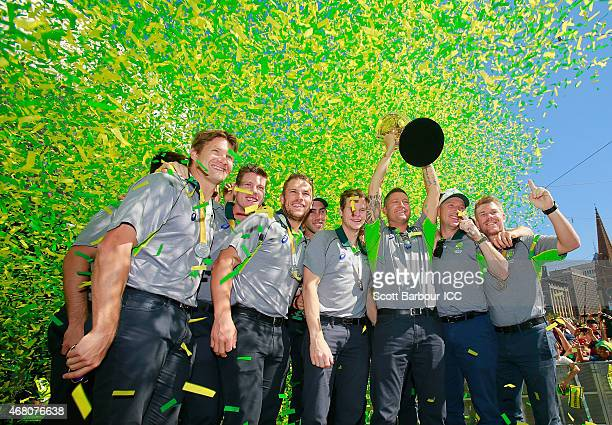 Australian captain Michael Clarke and the Australian team celebrate with the World Cup trophy during celebrations after winning the 2015 ICC Cricket...