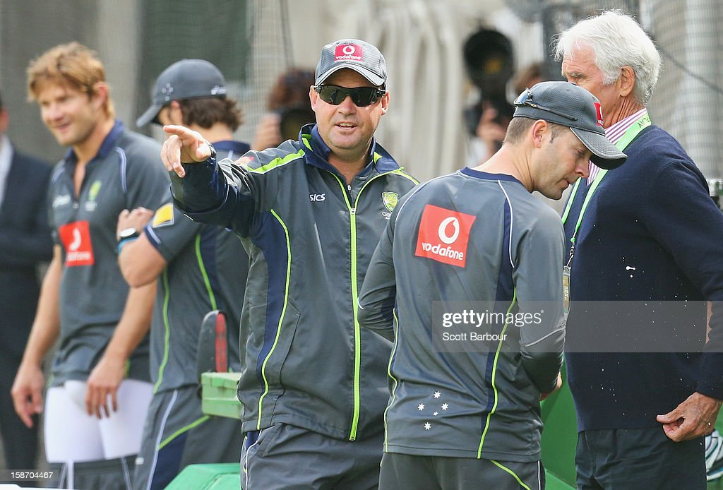 Australian captain Michael Clarke (2nd R), Australian Chairman of Selectors John Inverarity (R) and Australian coach <a gi-track='captionPersonalityLinkClicked' href=/galleries/search?phrase=Mickey+Arthur&family=editorial&specificpeople=789398 ng-click='$event.stopPropagation()'>Mickey Arthur</a> talk as <a gi-track='captionPersonalityLinkClicked' href=/galleries/search?phrase=Shane+Watson+-+Cricket+Player&family=editorial&specificpeople=171874 ng-click='$event.stopPropagation()'>Shane Watson</a> (L) pads up during an Australian nets session at Melbourne Cricket Ground on December 25, 2012 in Melbourne, Australia.