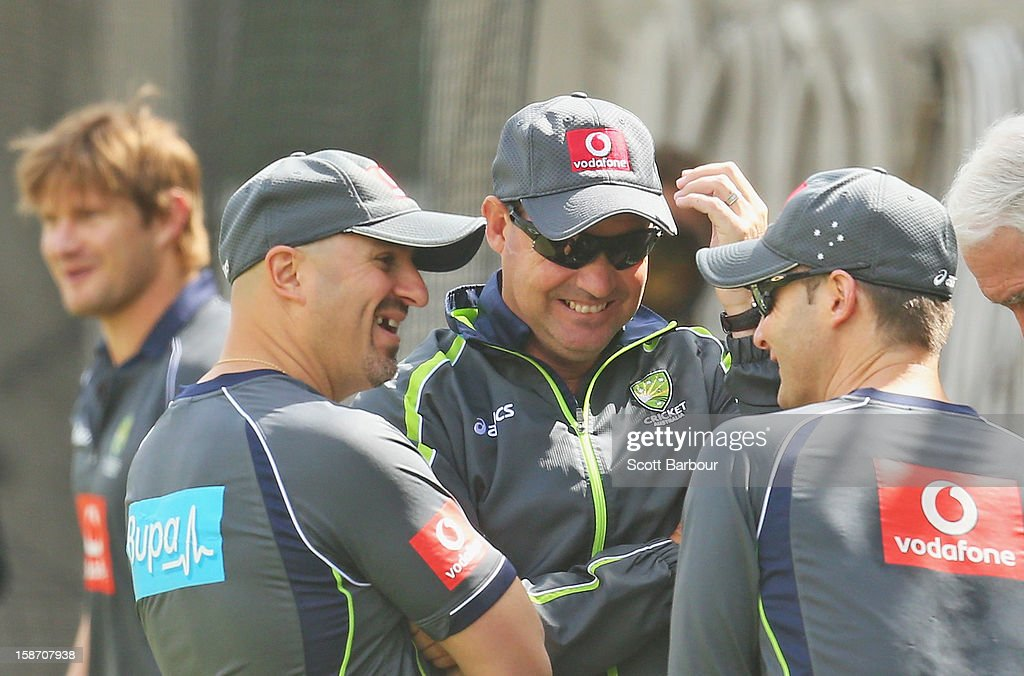 Australian captain Michael Clarke (R), Australian Cricket Team Physiotherapist Alex Kountouris and Australian coach <a gi-track='captionPersonalityLinkClicked' href=/galleries/search?phrase=Mickey+Arthur&family=editorial&specificpeople=789398 ng-click='$event.stopPropagation()'>Mickey Arthur</a> talk as <a gi-track='captionPersonalityLinkClicked' href=/galleries/search?phrase=Shane+Watson+-+Cricket+Player&family=editorial&specificpeople=171874 ng-click='$event.stopPropagation()'>Shane Watson</a> (L) pads up during an Australian nets session at Melbourne Cricket Ground on December 25, 2012 in Melbourne, Australia.