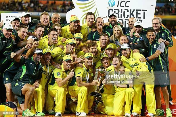 Australian captain Michael Clarke Australian players and support staff celebrate winning the 2015 ICC Cricket World Cup final match between Australia...