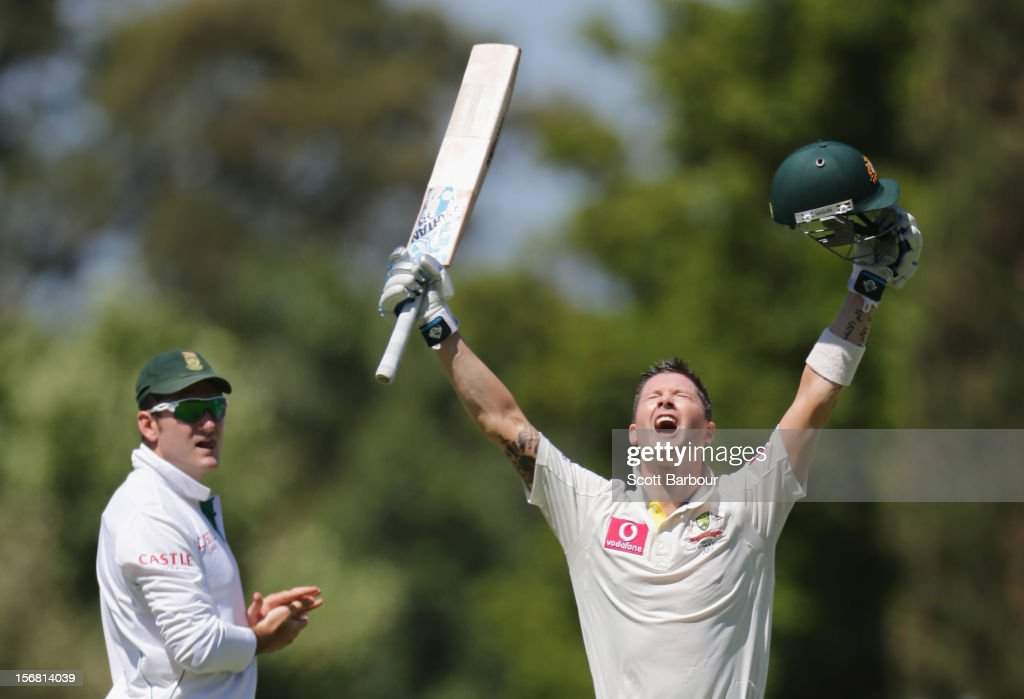 Australian captain Michael Clarke celebrates as he reaches his century as South African captain <a gi-track='captionPersonalityLinkClicked' href=/galleries/search?phrase=Graeme+Smith+-+Cricket+Player&family=editorial&specificpeople=193816 ng-click='$event.stopPropagation()'>Graeme Smith</a> looks on during day one of the 2nd Test match between Australia and South Africa at Adelaide Oval on November 22, 2012 in Adelaide, Australia.