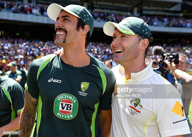 Australian captain Michael Clarke celebrates with teammate Mitchell Johnson after defeating England on the fourth day of the fourth Ashes cricket...