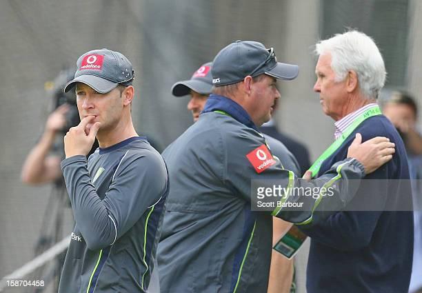 Australian captain Michael Clarke looks on as Australian Chairman of Selectors John Inverarity and Australian coach Mickey Arthur talk during an...