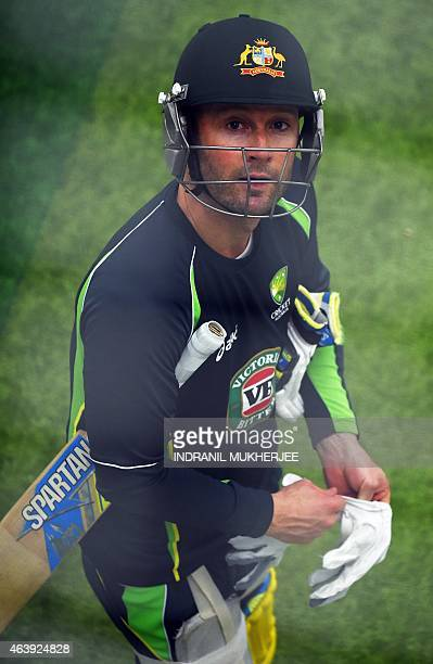 Australian captain Michael Clarke looks upwards as he prepares to bat in the nets during an indoor training session ahead of their 2015 Cricket World...