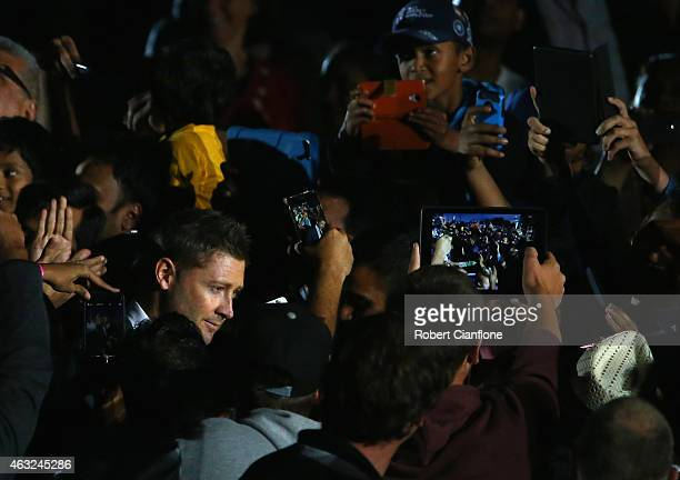 Australian captain Michael Clarke makes his way through the crowd during the Opening Ceremony ahead of the ICC 2015 Cricket World Cup at the Myer...