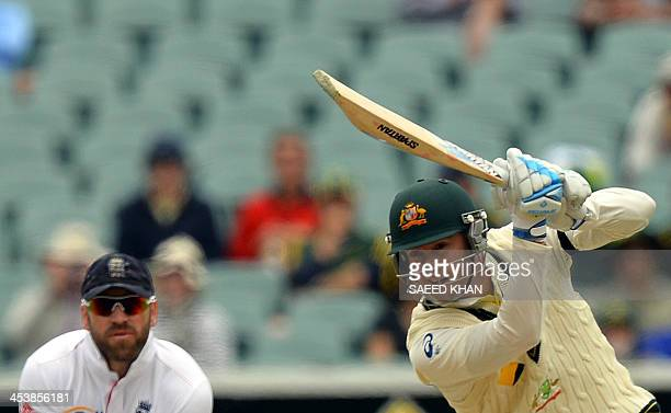 Australian captain Michael Clarke plays a shot as England's wicketkeeper Matt Prior looks on during day two of the second Ashes Test cricket match in...