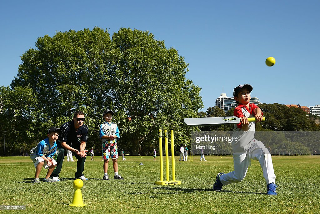 Australian captain Michael Clarke plays cricket with children during the launch for Cricket Australia's junior sports program MILO T20 Blast at...
