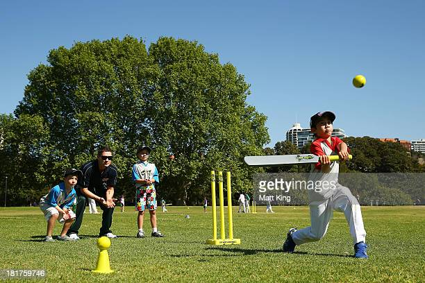 Australian captain Michael Clarke plays cricket with children during the launch for Cricket Australia's junior sports program MILO T20 Blast at...