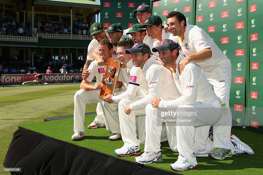 Australian captain Michael Clarke poses with team mates and the Warne–Muralidaran Trophy after winning the test during day four of the Third Test match between Australia and Sri Lanka at Sydney Cricket Ground on January 6, 2013 in Sydney, Australia.