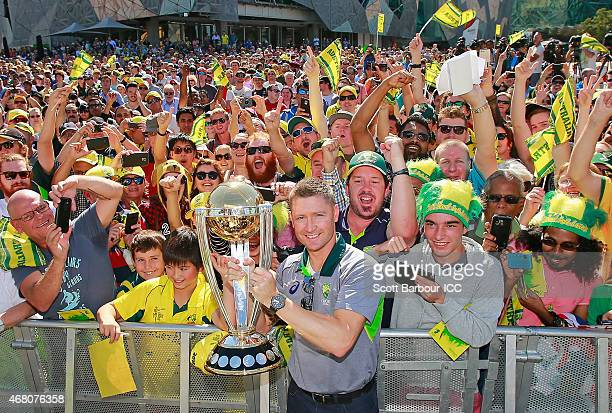 Australian captain Michael Clarke poses with the World Cup trophy and supporters during celebrations after winning the 2015 ICC Cricket World Cup...