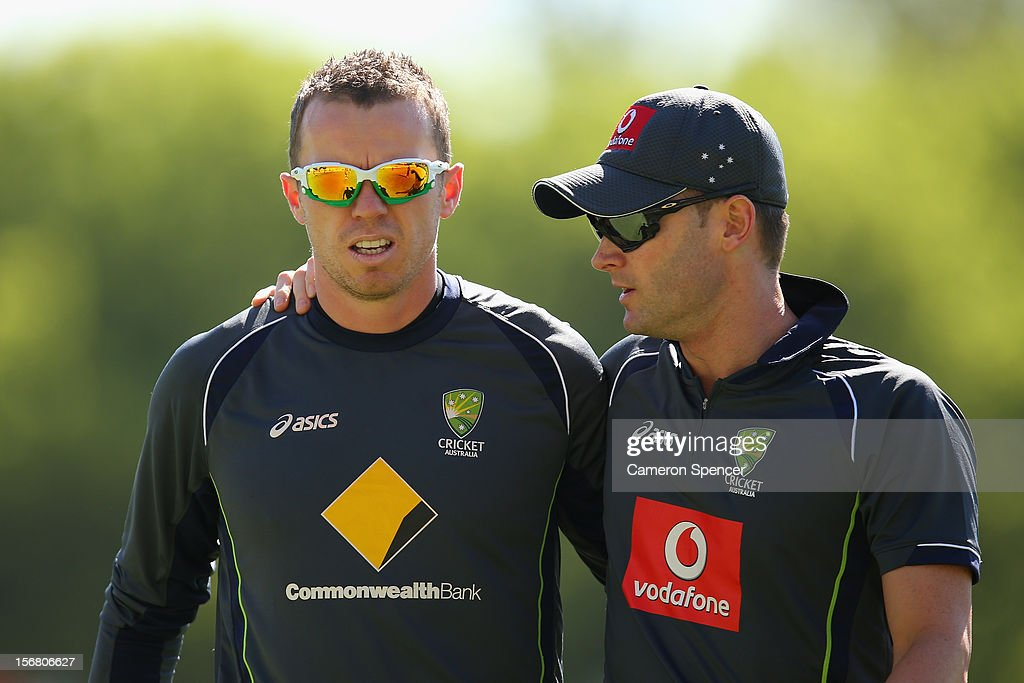 Australian captain Michael Clarke (R) talks to team mate Peter Siddle during the Australian team warm-up during day one of the 2nd Test match between Australia and South Africa at Adelaide Oval on November 22, 2012 in Adelaide, Australia.
