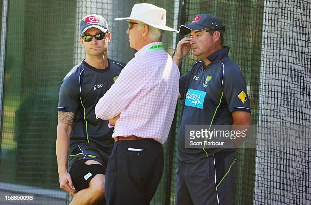 Australian captain Michael Clarke touches his injured hamstring as he talks with Australian Chairman of Selectors John Inverarity and Australian...