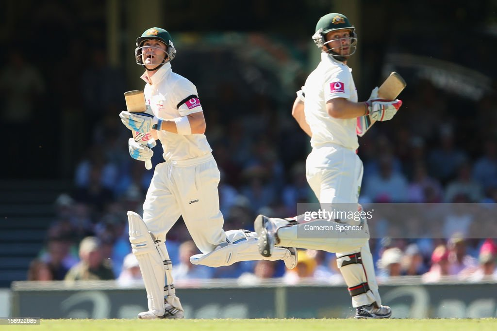 Australian captain Michael Clarke (L) watches a high ball with team mate Matthew Wade as they run between wickets during day two of the Third Test match between Australia and Sri Lanka at Sydney Cricket Ground on January 4, 2013 in Sydney, Australia.