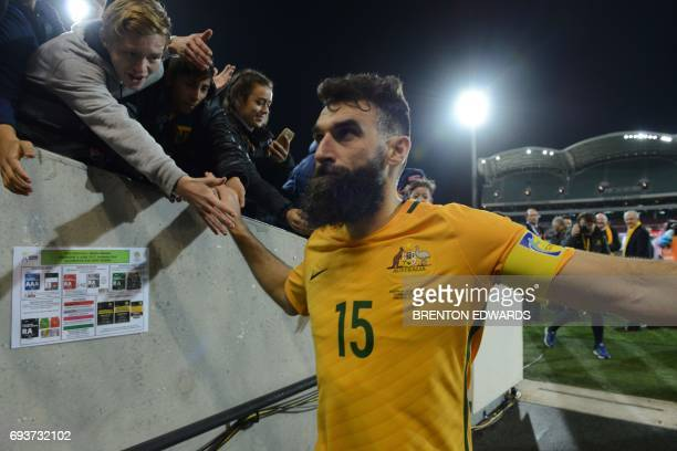 Australian captain Mile Jedinak leaves the field after his team won the World Cup football Asian qualifying match between Australia and Saudi Arabia...