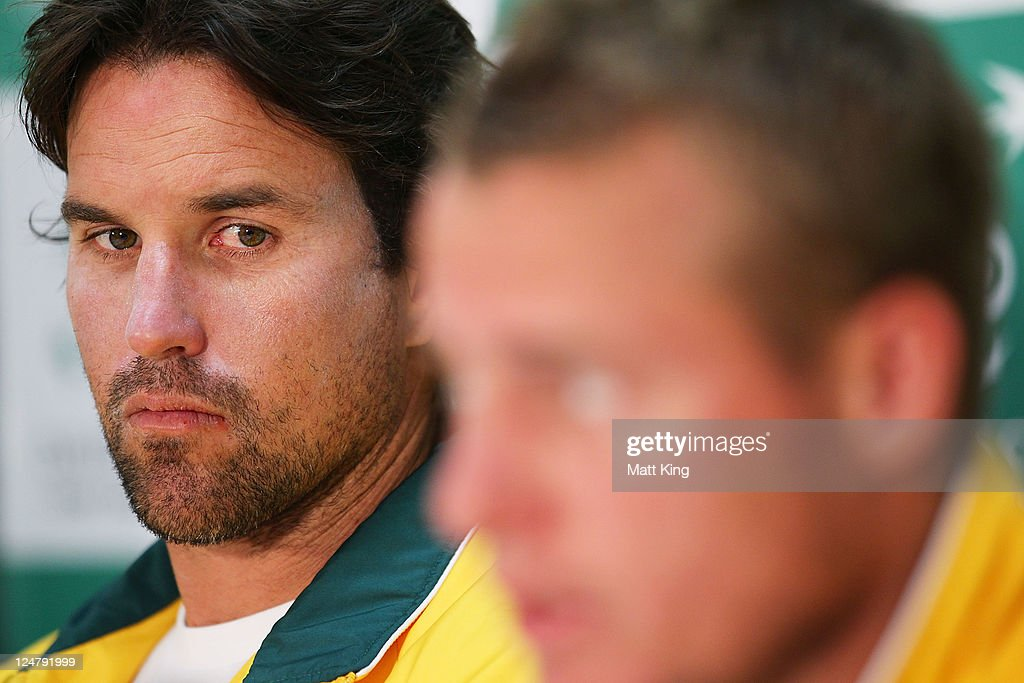 Australian captain Pat Rafter (L) looks on as <a gi-track='captionPersonalityLinkClicked' href=/galleries/search?phrase=Lleyton+Hewitt&family=editorial&specificpeople=167178 ng-click='$event.stopPropagation()'>Lleyton Hewitt</a> (R) of Australia speaks to the media during a press conference ahead of the Davis Cup World Group Playoff Tie between Australia and Switzerland at Royal Sydney Golf Club on September 13, 2011 in Sydney, Australia.