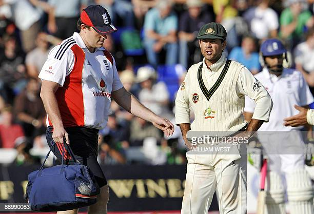 Australian captain Ricky Ponting reacts to England's physio Steve McCaig running on the field late in the day as England salvages a draw on the final...