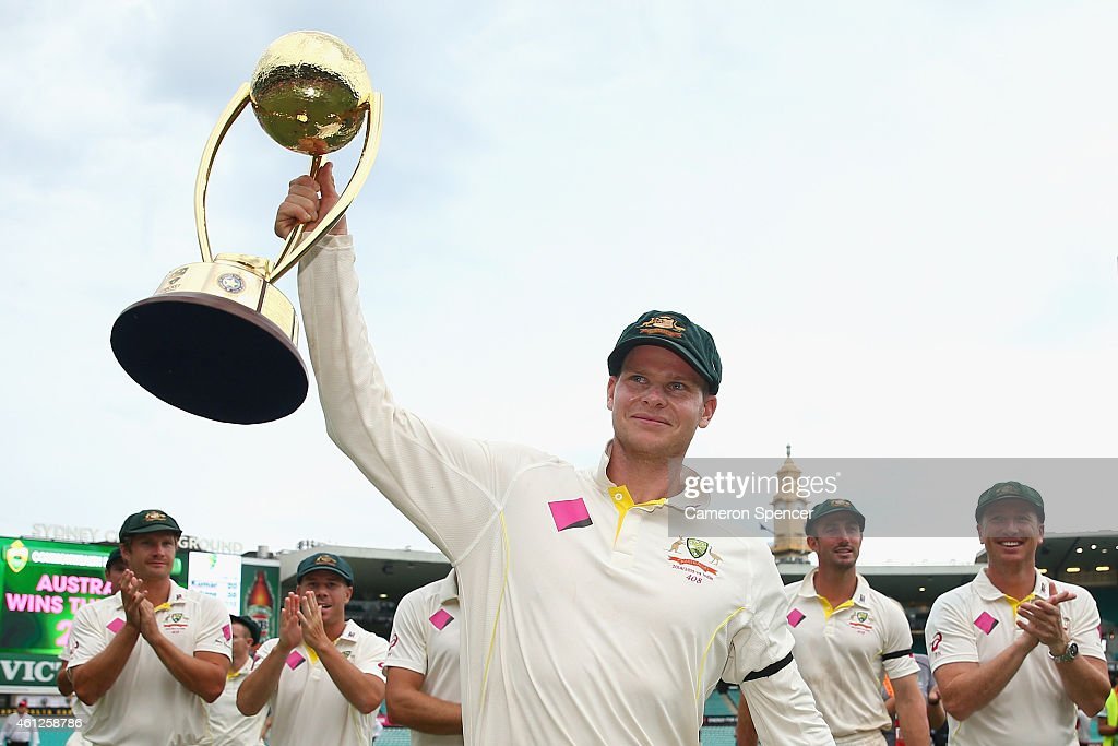 Australian captain Steve Smith holds the BorderGavskar trophy aloft after winning the series during day five of the Fourth Test match between...