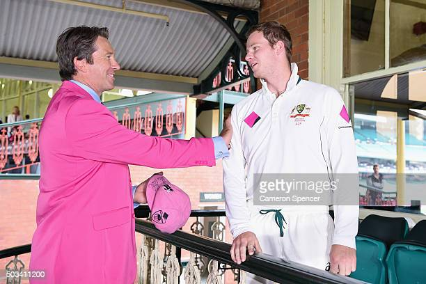 Australian captain Steve Smith presents Former Australian bowler Glenn McGrath with his Pink Cap on Jane McGrath Day during day three of the third...