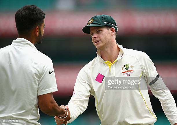Australian captain Steve Smith shakes hands with Virat Kohli of India after winning the series during day five of the Fourth Test match between...