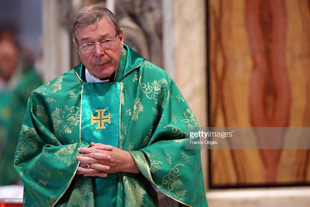 Australian cardinal <a gi-track='captionPersonalityLinkClicked' href=/galleries/search?phrase=George+Pell&family=editorial&specificpeople=695294 ng-click='$event.stopPropagation()'>George Pell</a> attends a mass for the opening of the Synod on the themes of family held by Pope Francis at St. Peter's Basilica on October 4, 2015 in Vatican City, Vatican. The director of the Holy See press office Father Federico Lombardi on Saturday reacting to revelations by a high-ranking Vatican official that he is in a gay relationship said 'the decision to make such a pointed statement on the eve of the opening of the Synod appears very serious and irresponsible, since it aims to subject the Synod assembly to undue media pressure'.