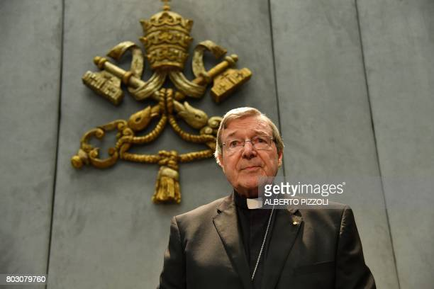 TOPSHOT CORRECTION Australian Cardinal George Pell looks on as he makes a statement at the Holy See Press Office Vatican city on June 29 2017 after...