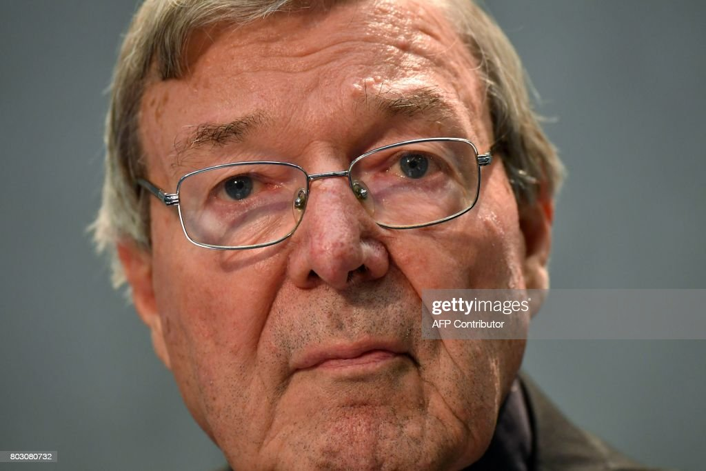 Australian Cardinal George Pell looks on as he makes a statement at the Holy See Press Office, Vatican city on June 29, 2017 after being charged with historical sex offences in a case that has rocked the church. Cardinal Pell says on June 29 that he will return to Australia to face sex abuse charges. / AFP PHOTO / Alberto PIZZOLI