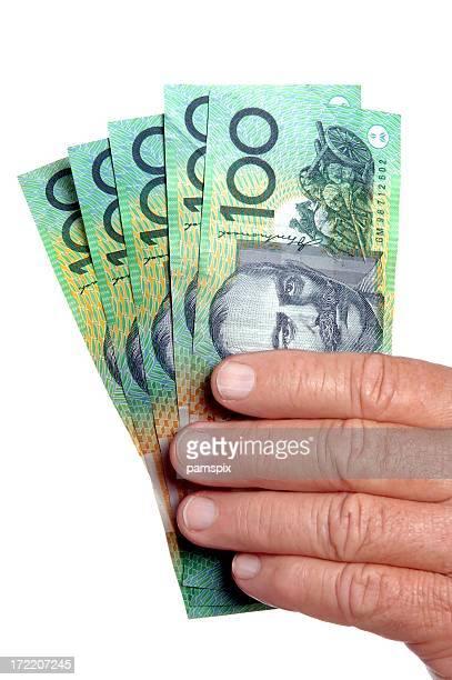 オーストラリア現金を手にした白背景