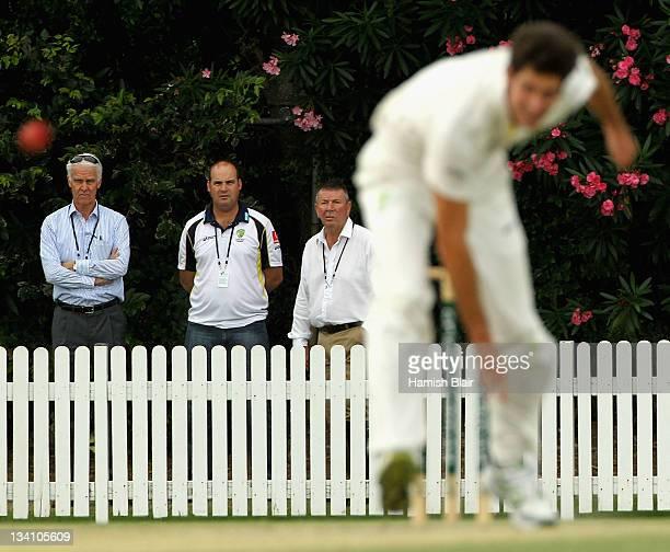 Australian Chairman of Selectors John Inverarity Australian Coach Micky Arthur and Selector Rod Marsh watch Ben Cutting of Australia A bowl during...