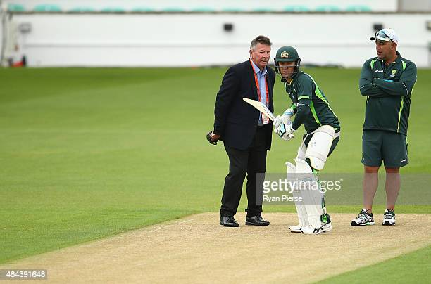Australian Chairman of Selectors Rod Marsh Michael Clarke of Australia and Australian coach Darren Lehmann inspect the pitch during a nets session...