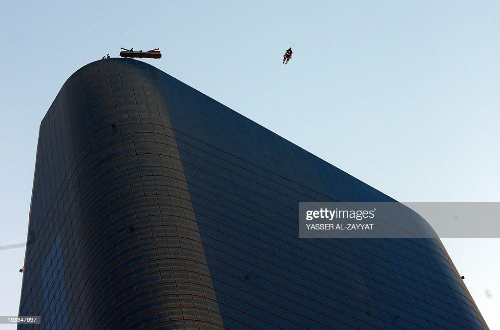 Australian Chris McDougall jumps from the top of Al-Hamra Tower, the tallest building in Kuwait, on March 8, 2013, in Kuwait city. Al-Hamra Tower is 414 meters high above sea-level and Kuwait's tallest tower, which has become a landmark. McDougall holds the record for trouble-free jumps, with 2,600 base jumps and 10,000 sky jumps.