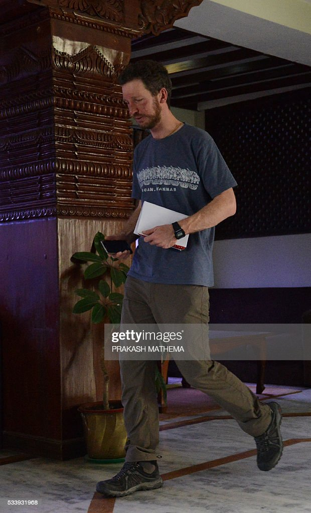 Australian climber Robert Gropel walks in a hotel lobby in Kathmandu on May 24, 2016, after being rescued from Mount Everest. Gropel's wife Maria Strydom died on May 21, while descending from the summit of Mount Everest from high-altitude sickness. The Australian climber was on her way down from Camp 4 to Camp 3 when she fell ill and died on, Pasang Phurba Sherpa, a board director at Seven Summit Treks, told AFP. / AFP / PRAKASH