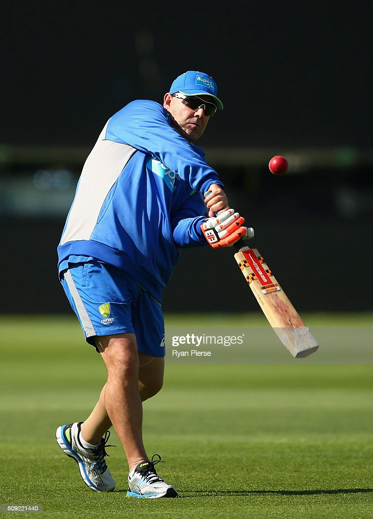 Australian coach <a gi-track='captionPersonalityLinkClicked' href=/galleries/search?phrase=Darren+Lehmann+-+Cricket+Player&family=editorial&specificpeople=171311 ng-click='$event.stopPropagation()'>Darren Lehmann</a> hits catches during an Australian nets session at Basin Reserve on February 11, 2016 in Wellington, New Zealand.