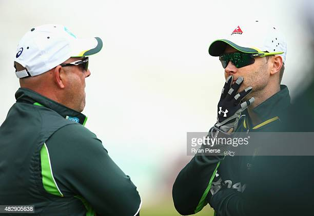 Australian coach Darren Lehmann speaks with Michael Clarke of Australia during a nets session ahead of the 4th Investec Ashes Test match between...