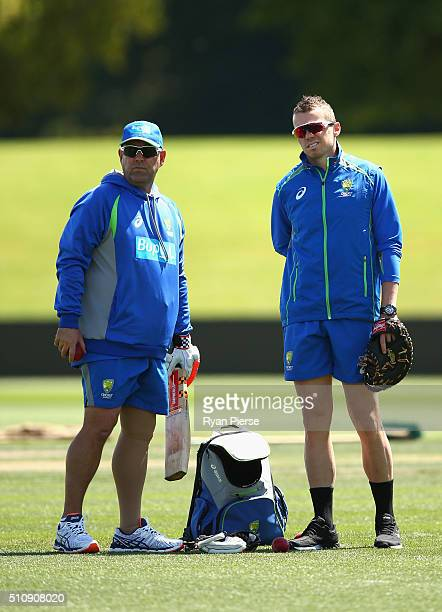 Australian coach Darren Lehmann speaks with Peter Siddle of Australia during an Australia nets session at Hagley Oval on February 18 2016 in...