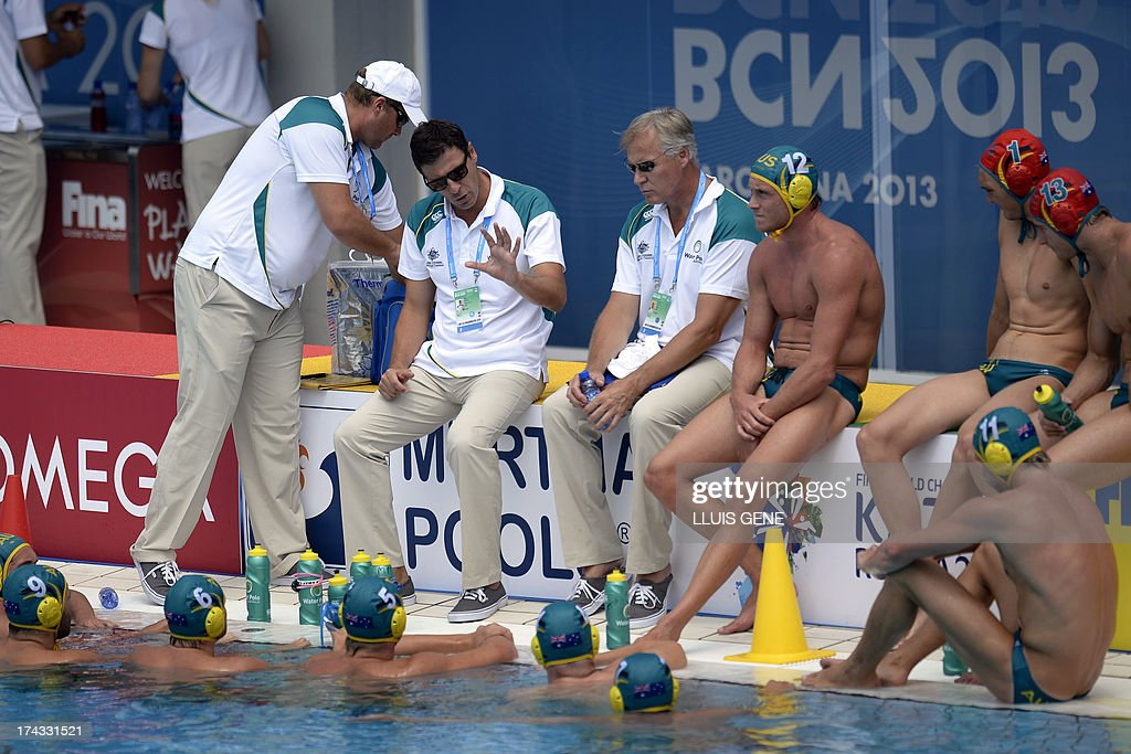 Australian coach Elvis Fatovic (L) gives instructions to his players during the preliminary round match of the men's water polo competition between China and Australia at the FINA World Championships at the Bernat Picornell swimming pool in Barcelona on July 24, 2013.