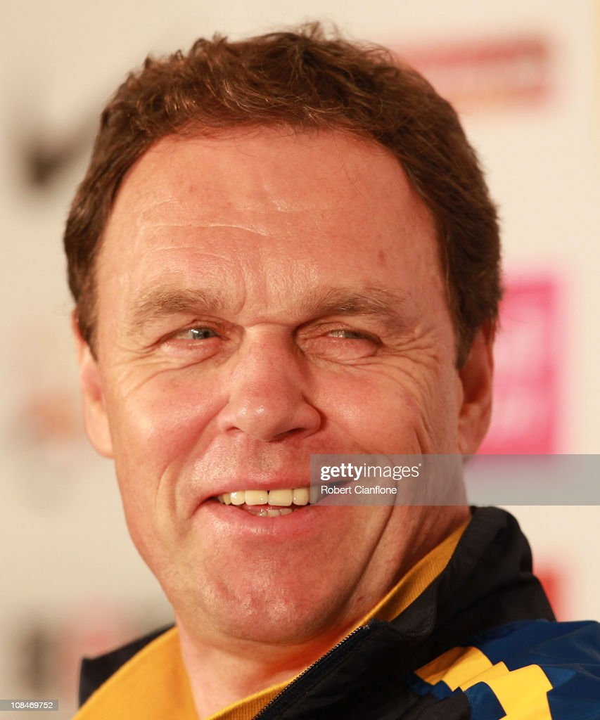 Australian coach <a gi-track='captionPersonalityLinkClicked' href=/galleries/search?phrase=Holger+Osieck&family=editorial&specificpeople=579862 ng-click='$event.stopPropagation()'>Holger Osieck</a> smiles as he talks to the media during an offical pre-match media conference at Khalifa Stadium on January 28, 2011 in Doha, Qatar.