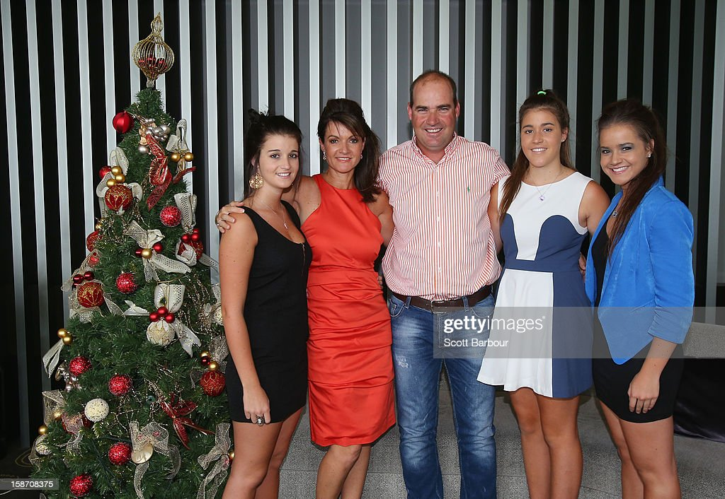 Australian coach <a gi-track='captionPersonalityLinkClicked' href=/galleries/search?phrase=Mickey+Arthur&family=editorial&specificpeople=789398 ng-click='$event.stopPropagation()'>Mickey Arthur</a> (C) poses with his family (L to R) Brooke, wife Yvette, Ashton and Kristin next to a Christmas tree ahead of a Cricket Australia Christmas Day lunch at Crown Entertainment Complex on December 25, 2012 in Melbourne, Australia.