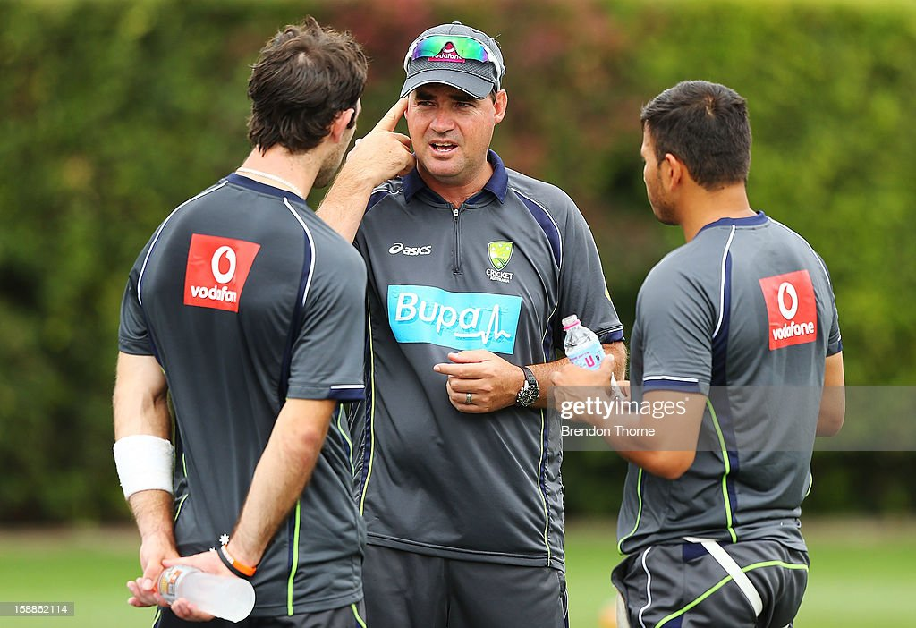 Australian Coach <a gi-track='captionPersonalityLinkClicked' href=/galleries/search?phrase=Mickey+Arthur&family=editorial&specificpeople=789398 ng-click='$event.stopPropagation()'>Mickey Arthur</a> speaks with <a gi-track='captionPersonalityLinkClicked' href=/galleries/search?phrase=Usman+Khawaja&family=editorial&specificpeople=4953179 ng-click='$event.stopPropagation()'>Usman Khawaja</a> and <a gi-track='captionPersonalityLinkClicked' href=/galleries/search?phrase=Glenn+Maxwell&family=editorial&specificpeople=752174 ng-click='$event.stopPropagation()'>Glenn Maxwell</a> of Australia during an Australian nets session at Sydney Cricket Ground on January 2, 2013 in Sydney, Australia.